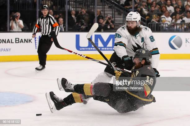 James Neal of the Vegas Golden Knights is checked off the puck by Brent Burns of the San Jose Sharks in the second period Game One of the Western...