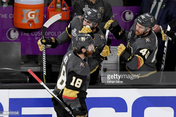 James Neal of the Vegas Golden Knights is congratulated by his teammates Alex Tuch and Ryan Carpenter at the bench after scoring a firstperiod goal...