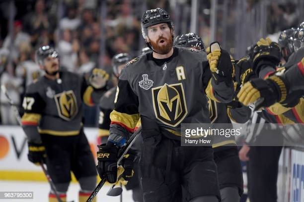 James Neal of the Vegas Golden Knights is congratulated by his teammates at the bench after scoring a firstperiod goal against the Washington...