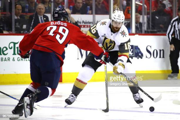 James Neal of the Vegas Golden Knights is defended by Christian Djoos of the Washington Capitals during the first period in Game Four of the 2018 NHL...