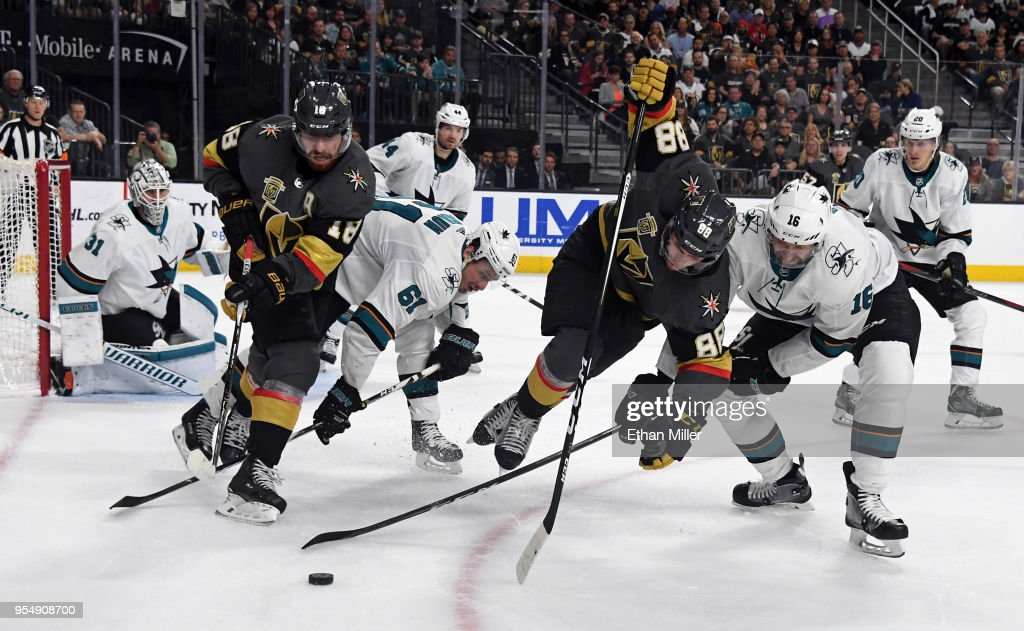 James Neal #18 of the Vegas Golden Knights, Justin Braun #61 of the San Jose Sharks, Nate Schmidt #88 of the Golden Knights and Eric Fehr #16 of the Sharks fight for the puck in the second period of Game Five of the Western Conference Second Round during the 2018 NHL Stanley Cup Playoffs at T-Mobile Arena on May 4, 2018 in Las Vegas, Nevada. The Golden Knights won 5-3.