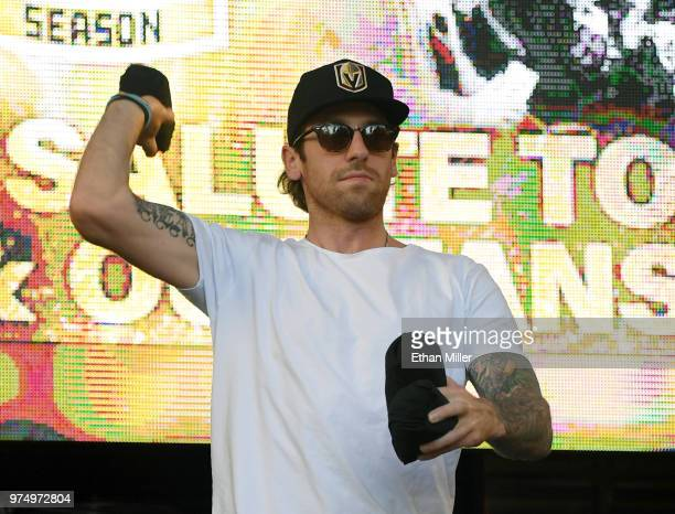 James Neal of the Vegas Golden Knights throws Tshirts to the crowd as he is introduced at the team's 'Stick Salute to Vegas and Our Fans' event at...