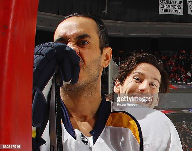 James Neal photobombs Mike Ribeiro prior to the game against the New Jersey Devils at the Prudential Center on December 20 2016 in Newark New Jersey