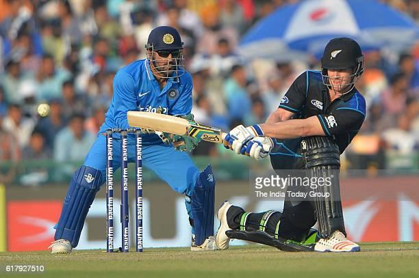 James Neesham of New Zealand bats during the third oneday international cricket match against New Zealand in Mohali