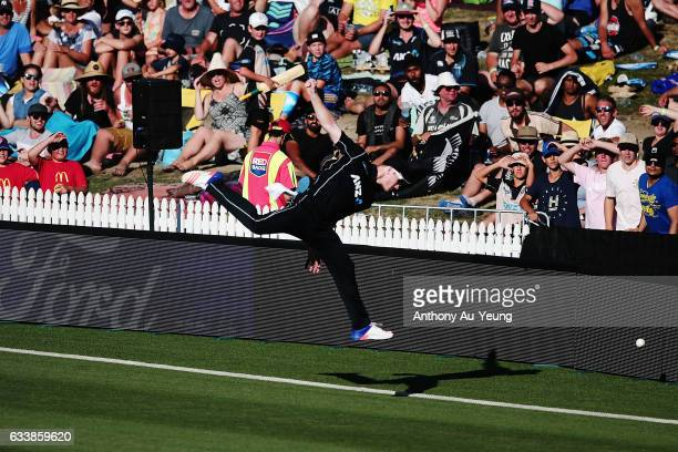 James Neesham of New Zealand couldn't stop a six going over the boundary during game three of the One Day International series between New Zealand...