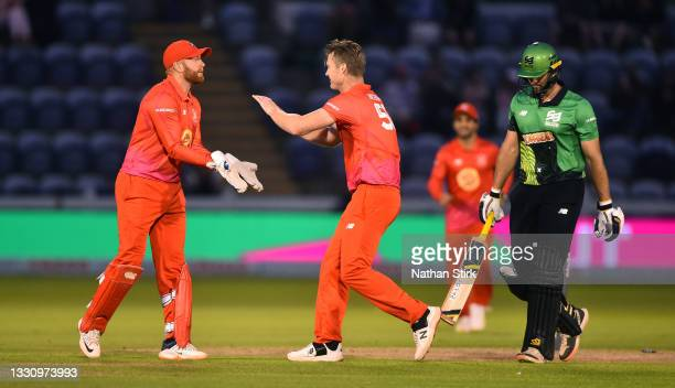 James Neesham of Welsh Fire celebrates with Jonny Bairstow after getting Ross Whiteley of Southern Brave out during The Hundred match between Welsh...
