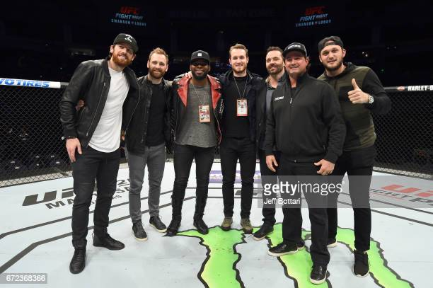 James Neil Harry Zolnierczyk PK Subban Colton Sissons Vern Fidler Anthony Bettedo pose in the Octagon after the UFC Fight Night event at Bridgestone...