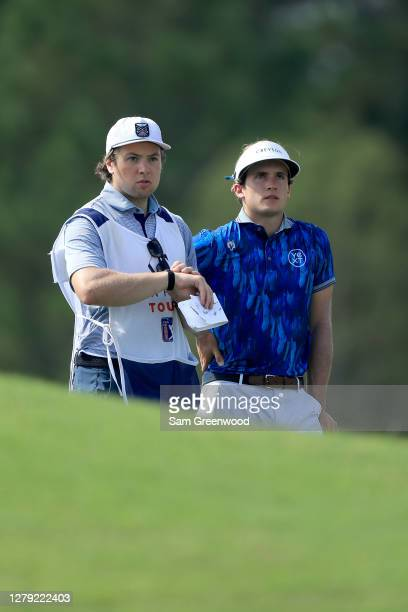 James Nicholas and caddie Charlie McAvoy of the Boston Bruins look over a shot on the 16th hole during the first round of the Orange County National...