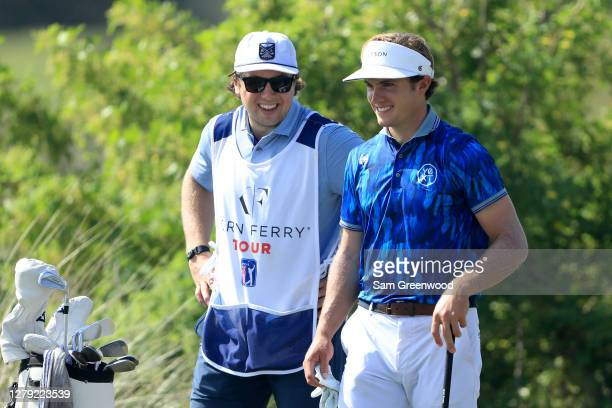 James Nicholas and caddie Charlie McAvoy of the Boston Bruins smile on the 17th hole during the first round of the Orange County National...