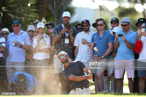 James Nitties of Australia plays out of a green side bunker on the second hole in the final match against Kiradech Aphibarnrat of Thailand during day...