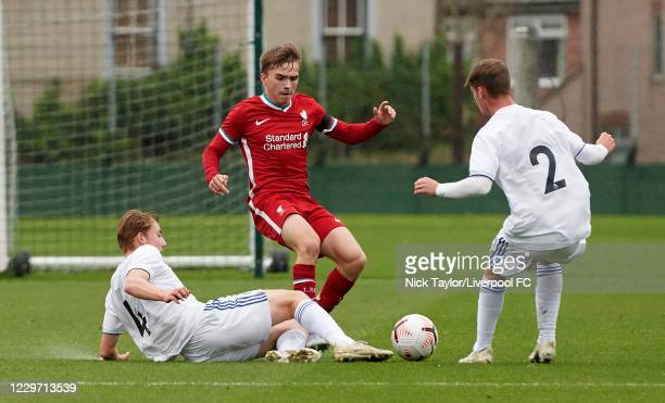 James Norris of Liverpool and Joe Snowdon and Harvey Sutcliffe of Leeds United in action at Melwood Training Ground on November 21, 2020 in...