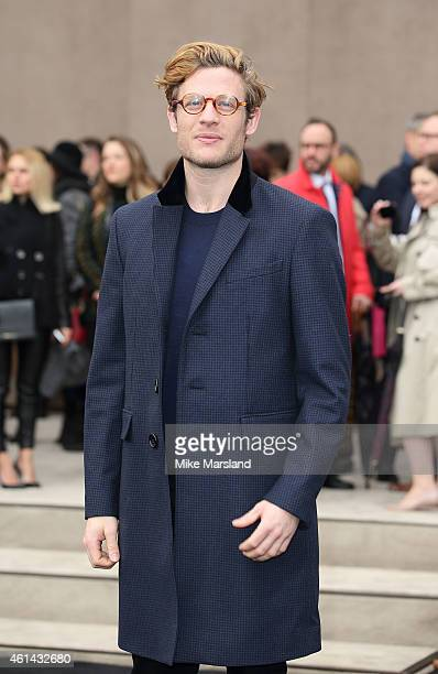 James Norton attends the Burberry Prorsum show at the London Collections Men AW15 at Kensington Gardens on January 12 2015 in London England