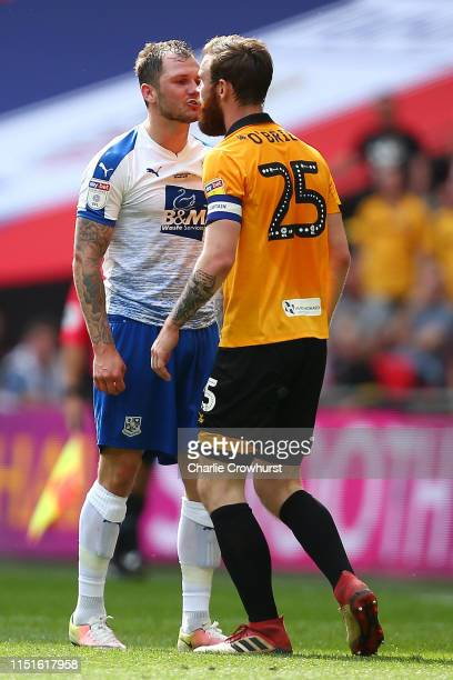 James Norwood of Tranmere Rovers confronts Mark O'Brien of Newport County after a foul by Mark O'Brien which leads to a second yellow, and therefore...