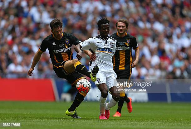 James Novak of Morpeth Town and Sirdic Grant of Hereford during The FA Vase Final match between Hereford FC and Morpeth Town at Wembley Stadium on...