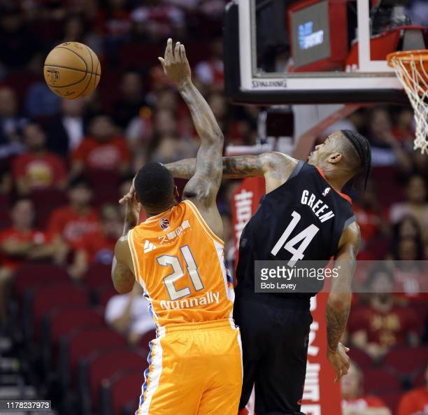 James Nunnally of the Shanghai Sharks has his shot attempt blocked by Gerald Green of the Houston Rockets during the first quarter at Toyota Center...