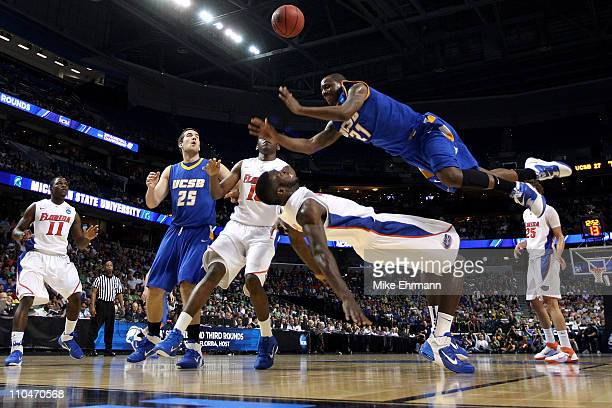 James Nunnally of the UC Santa Barbara Gauchos falls as he loses the ball driving against Patric Young of the Florida Gators in the second half...
