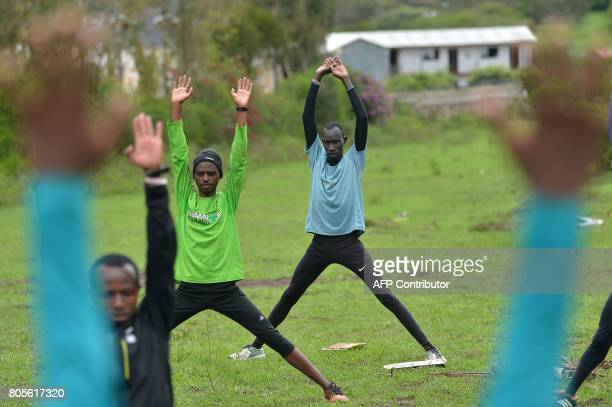 James Nyang Chiengjiek , a South Sudanese refugee and 400m Olympian at the Rio Olympic Games stretches alongside fellow refugees on May 12, 2017...