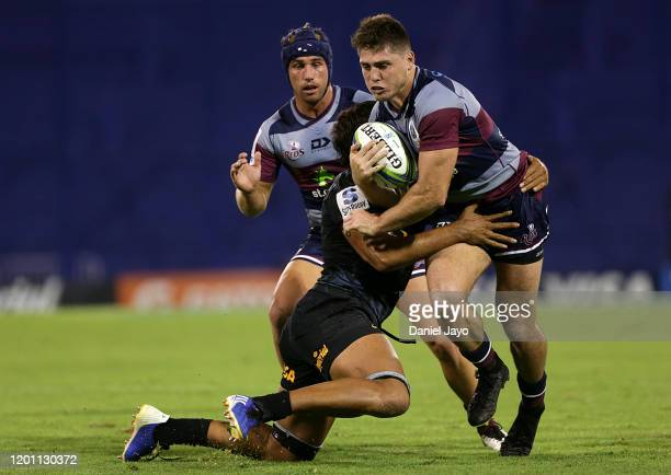 James O Connor of Reds is tackled by Tomas Lezana of Jaguares during a match between Jaguares and Reds as part of Super Rugby 2020 at Jose Amalfitani...