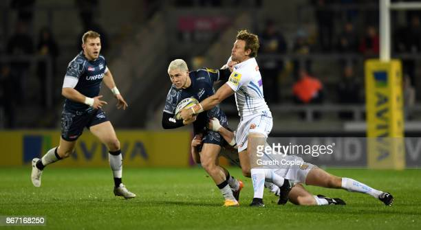 James O'Connor of Sale is tackled by Lachie Turner of Exeter during the Aviva Premiership match between Sale Sharks and Exeter Chiefs at AJ Bell...