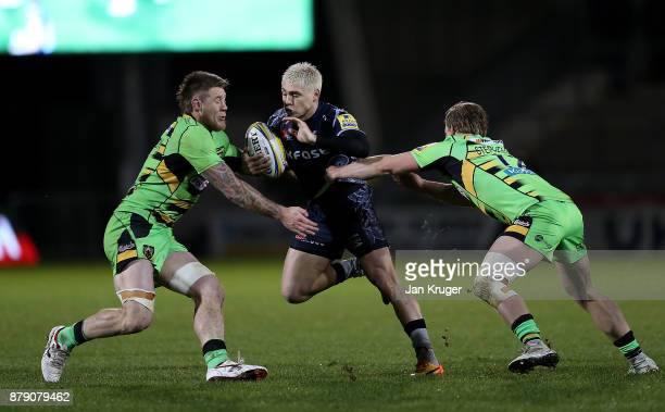 James O'Connor of Sale Sharks crashes into Teimana Harrison and Tom Stephenson of Northampton during the Aviva Premiership match between Sale Sharks...