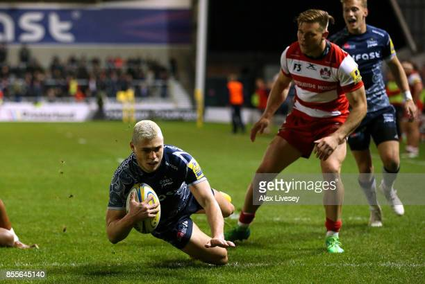 James OConnor of Sale Sharks dives over the line to score a try during the Aviva Premiership match between Sale Sharks and Gloucester Rugby at AJ...