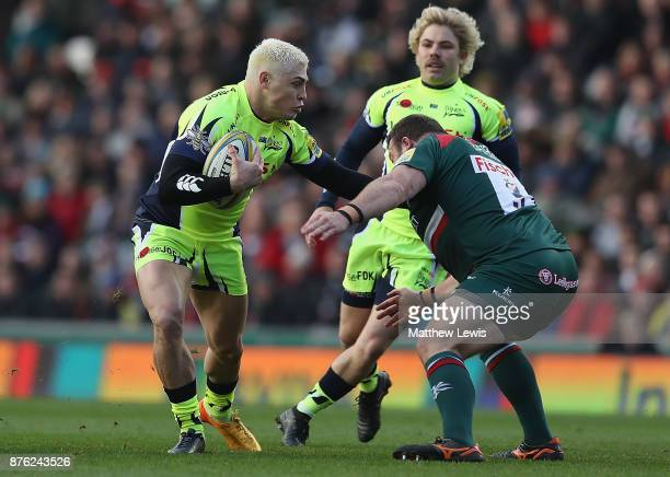 James O'Connor of Sale Sharks hands off Pat Cilliers of Leicester Tigers during the Aviva Premiership match between Leicester Tigers and Sale Sharks...