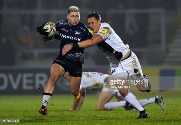 James OConnor of Sale Sharks is tackled by James Wilson of Bath Rugby during the Aviva Premiership match between Sale Sharks and Bath Rugby at AJ...