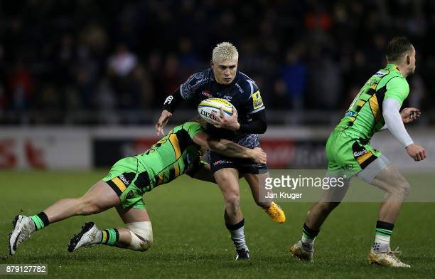 James O'Connor of Sale Sharks is tackled by Tom Stephenson of Northampton during the Aviva Premiership match between Sale Sharks and Northampton...