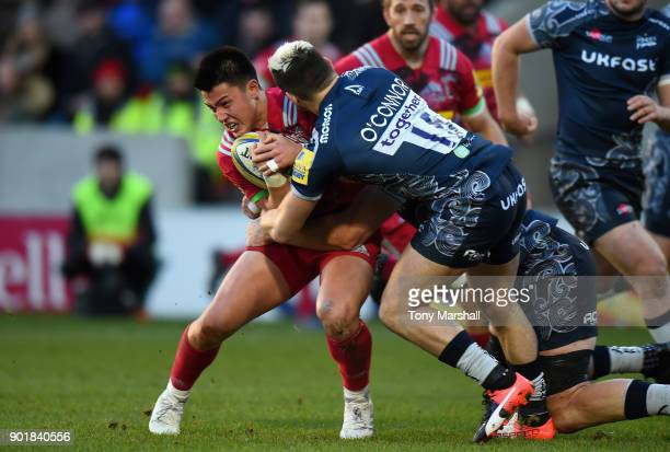 James OConnor of Sale Sharks tackles Marcus Smith f Harlequins during the Aviva Premiership match between Sale Sharks and Harlequins at AJ Bell...