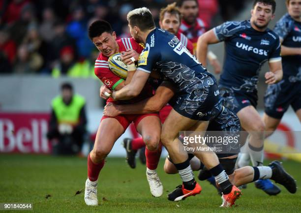 James OConnor of Sale Sharks tackles Marcus Smith of Harlequins during the Aviva Premiership match between Sale Sharks and Harlequins at AJ Bell...