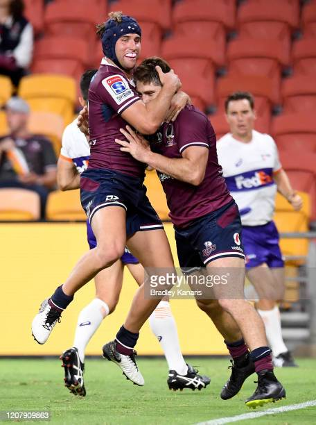 James O'Connor of the Reds celebrates with team mate Tate McDermott after scoring a try during the round four Super Rugby match between the Reds and...