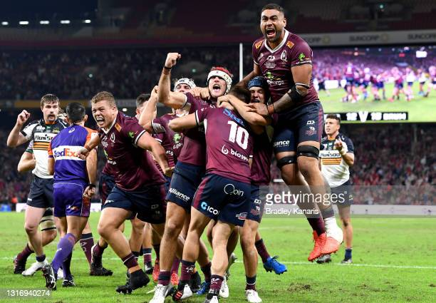 James O'Connor of the Reds is congratulated by team mates after scoring the match winning try during the Super RugbyAU Final match between the...