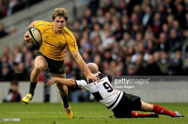 James O'Connor of The Wallabies hands off Peter Stringer of the Barbarians during the Killik Cup match between the Barbarians and Australia at...