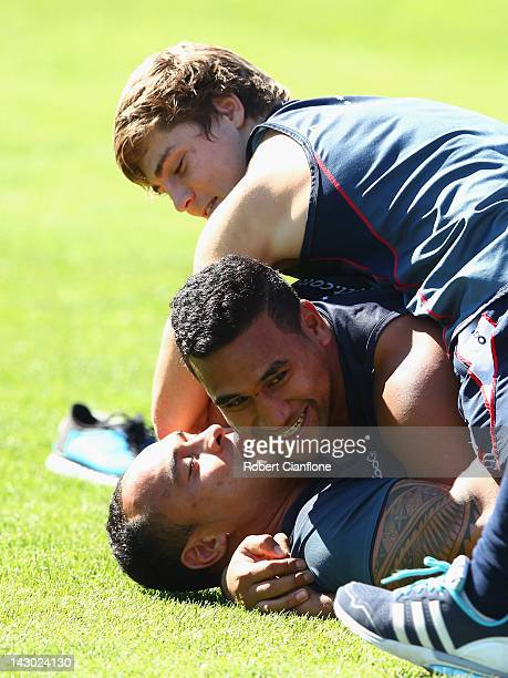 James O'ConnorCooper Vuna and Lloyd Johansson wrestle during a Melbourne Rebels Super Rugby training session at Visy Park on April 18 2012 in...