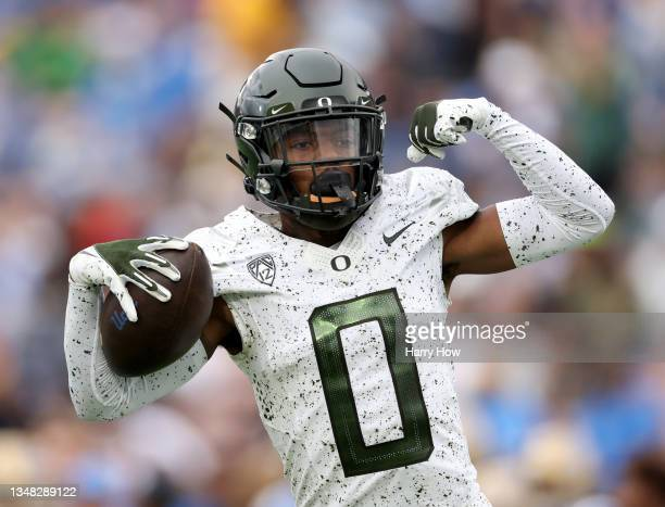 James of the Oregon Ducks celebrates his interception during the first half against the UCLA Bruins at Rose Bowl on October 23, 2021 in Pasadena,...