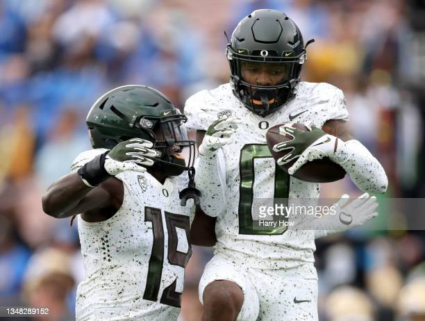 James of the Oregon Ducks celebrates his interception with Jamal Hill during the first half against the UCLA Bruins at Rose Bowl on October 23, 2021...