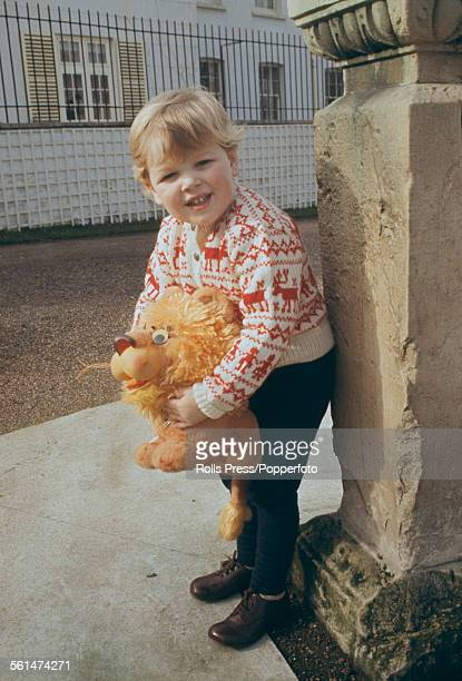 James Ogilvy son of Princess Alexandra of Kent and Angus Ogilvy pictured holding a toy lion during third birthday celebrations at Thatched House...