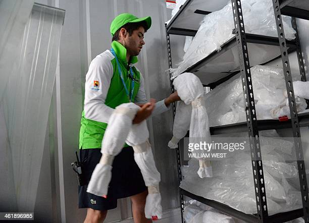 James O'Grady of court services and operations prepares ice vests and ice filled collars for players ahead of the 2014 Australian Open tennis...