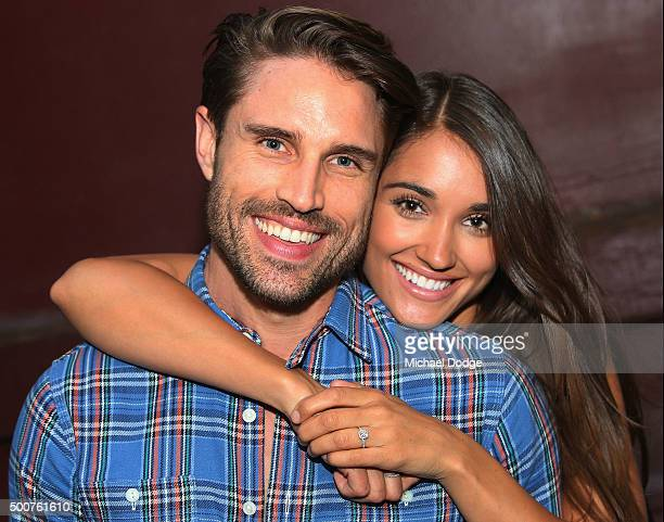 James O'Halloran from the Price Is Right USA and fiancee Jaimee Gooley pose during the Chadwick Models Christmas Celebration on December 10 2015 in...