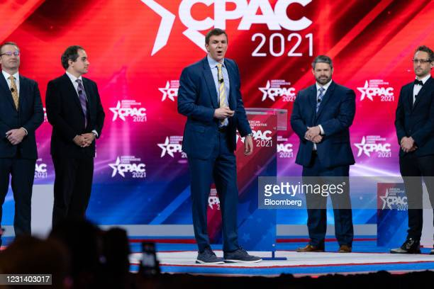 James O'Keefe, founder of Project Veritas, center, speaks during the Conservative Political Action Conference in Orlando, Florida, U.S., on Friday,...