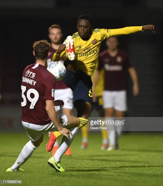 James Olayinka of Arsenal challenges Joe Bunney of Northampton for the ball during the Leasingcom match between Northampton Town and Arsenal U21 at...