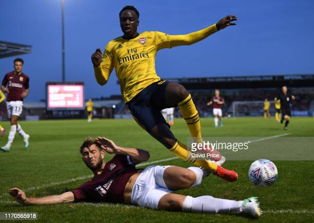 James Olayinka of Arsenal is tackled by Charlie Goode of Northampton during the Leasingcom match between Northampton Town and Arsenal U21 at PTS...