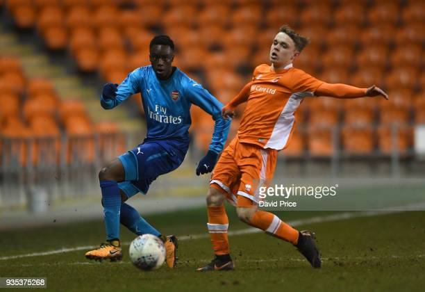James Olayinka of Arsenal passes the ball under pressure from Fin SinclairSmith of Blackpool during the match between Blackpool and Arsenal at...