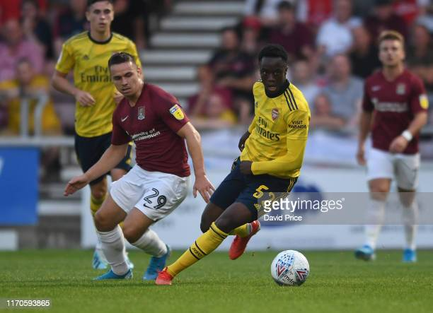 James Olayinka of Arsenal takes on Billy Waters of Northampton during the Leasingcom match between Northampton Town and Arsenal U21 at PTS Academy...