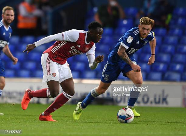 James Olayinka of Arsenal takes on Teddy Bishop of ipswich during the Leasingcom Cup match between Ipswich Town and Arsenal U21 at Portman Road on...
