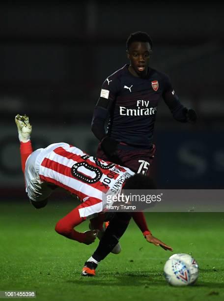 James Olayinka of Arsenal U21 upends Jacob Maddox of Cheltenham Town during the Checkatrade Trophy match between Cheltenham Town and Arsenal U21 at...