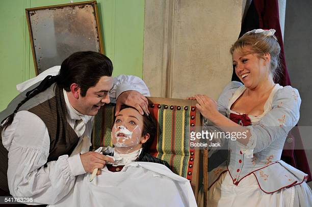 James Oldfield as Figaro Anna Grevelius as Cherubino and Sophie Evans as Susanna in Garsington Opera's production of Wolfgang Amadeus Mozart's Le...
