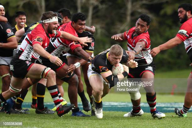 James OReilly of Wellington scores a try with Dan Hyatt of Counties Manukau during the round five Mitre 10 Cup match between Counties Manukau and...