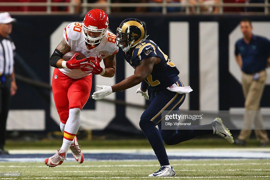 James O'Shaughnessy #80 of the Kansas City Chiefs makes a catch against Alec Ogletree #52 of the St. Louis Rams in the second quarter during a pre-season game at the Edward Jones Dome on September 3, 2014 in St. Louis, Missouri.