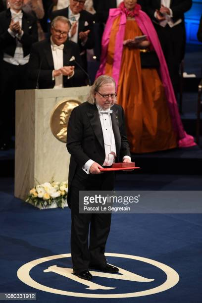 James P Allison laureate of the Nobel Prize in Physiology or Medicine acknowledges applause after he received his Nobel Prize from King Carl XVI...